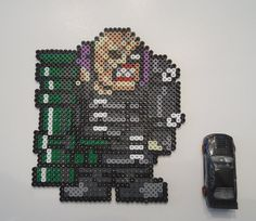 Hey, I found this really awesome Etsy listing at https://www.etsy.com/listing/184088589/resident-evil-nemesis-8-bit-bead-sprite