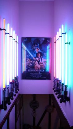 """AWESOME.  12 lightsabers and what appears to be an autographed """"Return of the Jedi"""" poster..."""