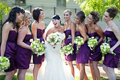 Plum dresses, green and white flowers.