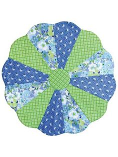 """Make this cute table topper in 1 evening! Great for using up scraps or fat quarters, just select 3, 4, 6 or 12 different fabrics and whip this versatile table topper together! Use seasonal fabrics to decorate your table during the holidays, or choose those pretty scraps for everyday use. The pattern has been tested to ensure it will lay flat. Sewing tips in the directions will teach you new techniques to incorporate into other sewing projects. Finished size is approximately 24 1/2"""" in ..."""