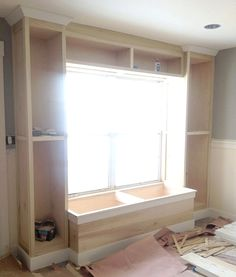 Built in bookcase and window seat. For the office? #RemodelingGarageIntoRoom