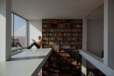 Radim Kralik lives with his wife, Barbora Kralikova, and their two children in a modern concrete house they built on top of a 1943 grain silo. The floor-to-ceiling bookshelf is filled with books inherited from his grandfather.