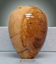 Greg Campbell Turned Wood Vessel by catrulz I HAVE TWO WOODEN VASES THAT I PUT THE EUCALYPTUS IN.  MINE ARE NOT THIS PRETTY, BUT I COULD SHINE THEM UP.  HMMM.