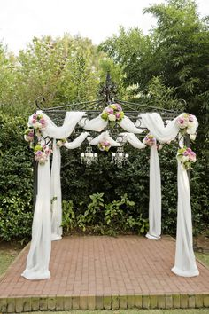 Burlap draping with country pink and green flowers over a wooden 21 amazing wedding arch canopy ideas outdoor weddingoutdoor wedding decorationspurple junglespirit Images