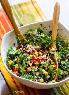 Creamy Mexican Kale Salad Recipe made with black beans, corn, peppers, tomato, cilantro and tossed with a tangy cumin flavoured avocado dressing. | ifoodreal.com