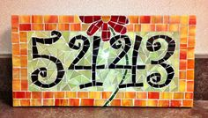 You are purchasing a handmade mosaic glass address plaque. Each plaque is custom made to your specifications and requires 4 to 8 weeks for completion, depending on how many orders Im processing. I hand cut each piece of glass to create your mosaic piece.  The address plaque comes in your choice of colors, font and orientation. You may select a horizontal or vertical orientation(please see pictures for examples). Horizontal plaques measure 7.5 by 13 and vertical plaques measure 5 by 18. If…