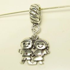 Boy and Girl Smaller Sterling Silver Dangle Charm by CharmS cool. $23.99. This is a Sterling Silver dangle charm featuring a pretty little girl and a little boy. Hangs from a Rope bail. Item slides on. This charm is compatible with all Pandora, Biagi, Chamillia and other European bracelets.