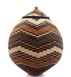 Africa   'Ukhamba' basket by Zulu weaver, Nomkhosi Nkosi   Palm fronts wrapped around coils of wild grass. Natural dyes.