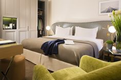 Le Marianne, Paris | Located near the Champs-Elysées in the 8th arrondissement,  this beautiful building from the Haussmann period has been transformed into a modern and comfortable hotel in a chic, contemporary style that embodies French savoir faire and joie de vivre. By Hotelied.