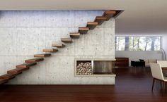 escalier suspendu de design moderne avec marches en bois et mur en béton brut
