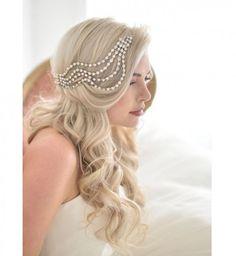 Idée coiffure de mariage : une mèche ondulée sur le côté