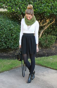 Adorable fall outfit. White top, black skirt and black tights.