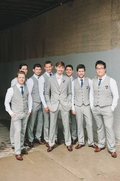 Groom & Groomsmen! All were in custom made suits from Indochino. The groomsmen had a two piece suit with a navy tie, and the groom had a three piece suit with a pink bow tie.