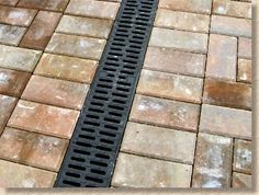 paving laid tight to linear channel Backyard Drainage, Landscape Drainage, Japanese Garden Backyard, Brick Border, Pool Pavers, Drainage Channel, Linear Drain, Garage Floor Coatings, Sewer System