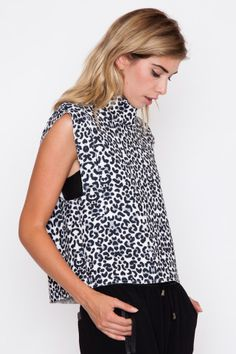 A snow leopard print top that hangs off the shoulders just slightly.