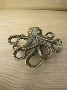 Awesome brass octopus cabinet knobs! The Octopus is all the rage for craft enthusiasts! While he may not have traversed the globe with Jules Verne, he will look ship-shape on your dresser or cabinet as a drawer knob! These fun cabinet knobs highlight one of the world′s most brilliant