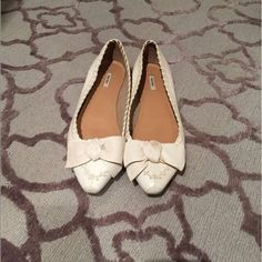 Miu Miu flats! Miu Miu white leather flats with a bow! Small smudge on the ball of the bow! Barely worn! Miu Miu Shoes Flats & Loafers