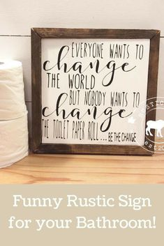Add some fun to your bathroom with this cute custom change the toilet paper framed wood sign. Perfect for either hanging or sitting on a shelf! #ad #wallart #walldecor #rusticsigns #giftideas