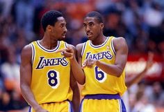 31 Oct 1997:  Guards Kobe Bryant (left) and Eddie Jones of the Los Angeles Lakers talk during a game against the Utah Jazz at the Great Western Forum in Inglewood, California.  The Lakers won the game 104-87. Mandatory Credit: Aubrey Washington  /Allsport