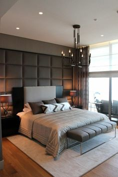 Leather panelling accent wall can add luxurious character to your bedroom.