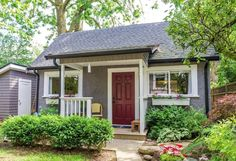 Look inside this pristine backyard cottage: the kitchen is gorgeous