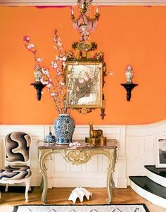 orange wall with white base board; just like the London house in The Parent Trap