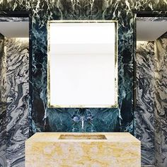 "Surfaces are far from timid in today's most impactful bathrooms. Stone in unexpected hues and allover pattern have caught top designers attention, like Rafael de Cárdenas of @architectureatlarge, who used three marbles in different colors and grain size for a project in England, shown here. ""The veining on one is so rococo, it's almost figurative,"" he says. See more of the most exciting trends in bathroom design, and the #ADGreatDesign2018 award-winning products through the link in our…"