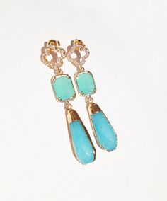 f51e0d85c Wonderful blue jade teardrop stones are capped in 24kt gold and accented  with mint-hued detail. Quatrefoil posts finish the pair, which are dotted