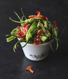 Thumb-size pimiento de padrón peppers make a great savory appetizer or snack when stir-fried with garlic and serrano ham.