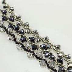 Crystal Splendor is a deliciously long necklace - lariat created using three delicately beaded chains, complimented with fluffy fringe, and held together with a beaded bead. Kit includes thunder polis