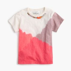 A comfy, colorful T-shirt that sports a built-in sparkly necklace makes accessorizing in the morning as easy as throwing on this top. <ul><li>Cotton.</li><li>Long sleeves.</li><li>Machine wash.</li><li>Import.</li><li>Online only.</li></ul>