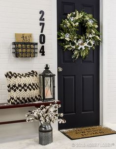 Incorporate front door decor that provides a welcoming energy to your guests!