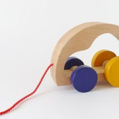A minimalistic yet classic toy!  Who of us does not remember his/her first pull toy? It is the timeless type of toy which gives much joy and fun to the just-ready-to-walk toddlers. We kept it simple with curved forms, satin smooth natural wood surfaces and details of vivid colour. Elegant in its essence, contrasts sharply to the batery-operated, noise-making plastic toys.