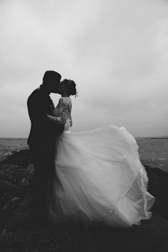 windswept photo of bride and groom