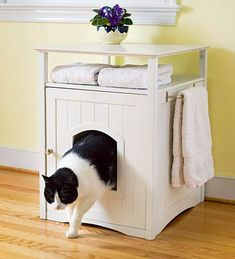 Cat Litter Box Cabinet with Stainless Steel Towel Bar. This might work in my small bathroom.