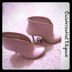 """✂️FINAL PRICE✂️ New BARNEY'S NY Co-Op Ankle Boots Brand New Ivory Ankle Boots Size 8M. Beautiful soft leather. 5"""" heel, rounded toes, slits in back, elastic front. Easy slip on and very comfortable. Ivory, winter white is perfect for the upcoming season. From my closet to yours! Barneys New York CO-OP Shoes Ankle Boots & Booties"""