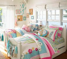 Too cute!  Love the surf/beach bedding.  May have to buy for Maddie's room now for when she's a little older.