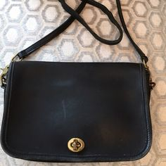 Coach Vintage Black Leather Cross Body Bag Brass hardware.  Turn lock closure.  Interior zip pocket.  Back open pocket.  Pocket under flap.  Leather.  Bag shows some fading/wear.  Measures: 9.5x2x6.5x21. Coach Bags Crossbody Bags