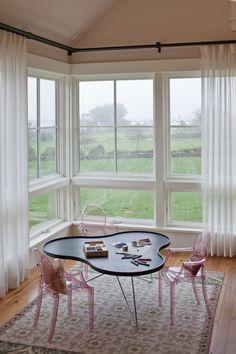 play corner of girl's bedroom:  sheer curtains w/black hardware