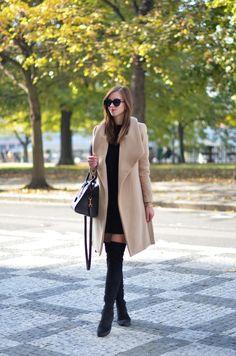 Barbora Ondrackova wears a black mini dress and a camel overcoat with a pair of over the knee boots. Dress: Topshop , Coat: Mango, Boots: Stuart Weitzman, Bag: Saint Laurent.