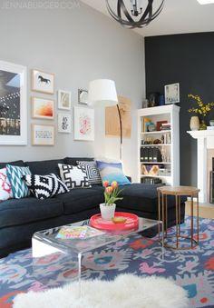 Living Room Makeover with bold black + pops of color [emerald, raspberry, coral, and light blue] Design by Jenna Burger Design, www.jennaburger.com