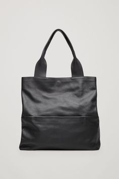 COS image 1 of Large grained leather bag in Black
