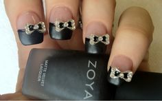 Black French nails with bow- I like the matte tips, but the bow maybe on just one nail, all is a little much