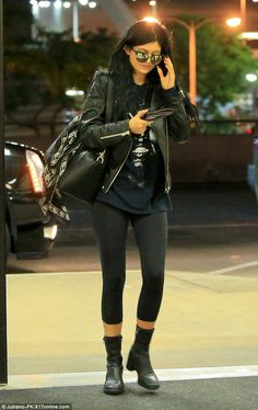 Kylie Jenner teamed a leather jacket with a baggy black T-shirt and casual leggings at LAX airport http://dailym.ai/1ta49hm