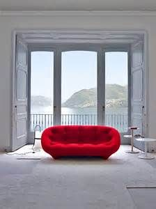 ploum sofa ligne roset. Gorgeous shape, fabulous colour, quirky. Love the room height and the space given to the sofa