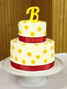 red and yellow polka dot two-tier wedding cake