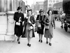 Women on the way to work in London, August 1939. The boxes they are carrying contain gas masks.