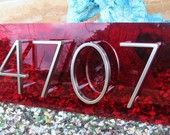 Plexiglass behind house numbers adds a shot of color.