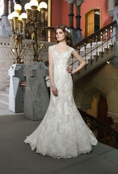 Brides: Justin Alexander - Fall 2014. Style 8725, beaded metallic Venice lace trumpet wedding dress with a Queen Anne neckline and cap sleeves, Justin Alexander