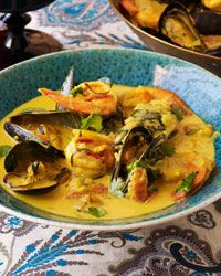 Curried Coconut-Seafood Soup (Seafood Rassa) Recipe from Food & Wine. This site tells you what wine would pair well with the dish. Love it!